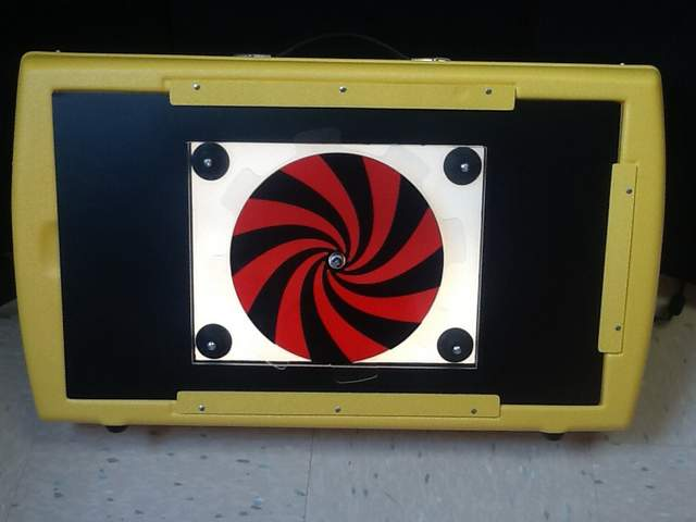 Red/black spinner overlay on a Light Box
